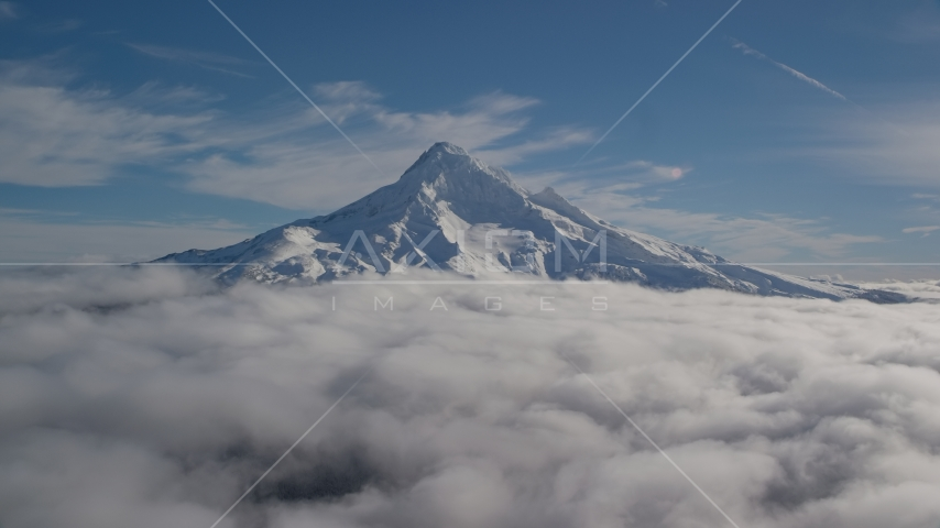 Mount Hood's snowy summit with low clouds, Mount Hood, Cascade Range, Oregon Aerial Stock Photos | AX154_070.0000206F