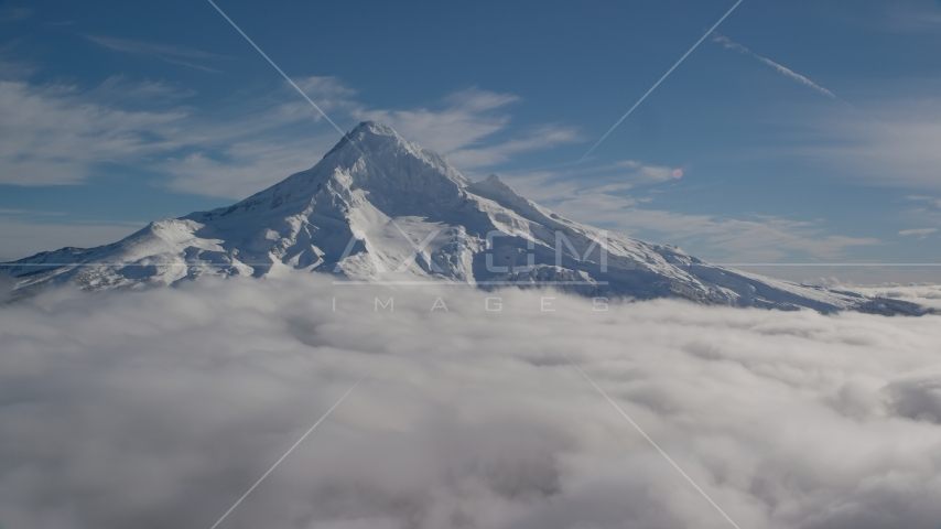 The Mount Hood summit with snow and low clouds, Mount Hood, Cascade Range, Oregon Aerial Stock Photos | AX154_072.0000320F