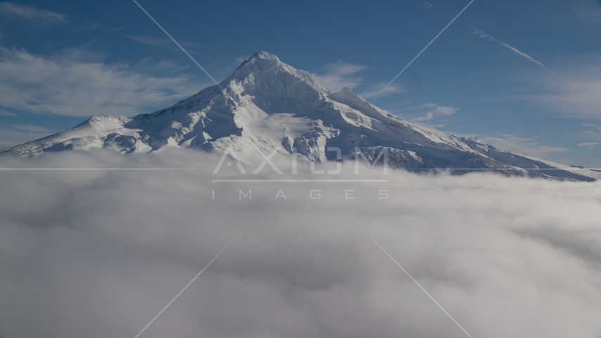 The Mount Hood summit with snow and low clouds, Cascade Range, Oregon Aerial Stock Photos | AX154_074.0000339F