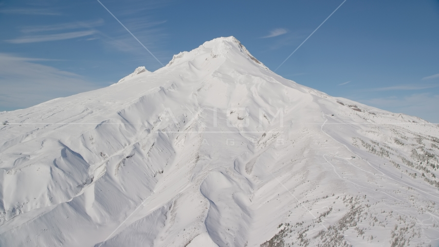 Snow-covered mountain slopes of Mount Hood, Cascade Range, Oregon Aerial Stock Photos | AX154_096.0000000F