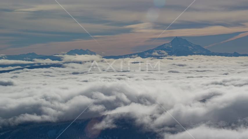 Mount Jefferson and Three Sisters Volcanoes, seen above the clouds, Cascade Range, Oregon Aerial Stock Photos | AX154_099.0000300F