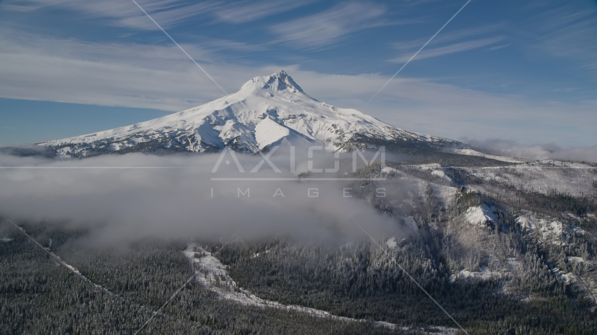 Low clouds over evergreen forest near the peak covered in snow, Mount Hood, Cascade Range, Oregon Aerial Stock Photos | AX154_109.0000000F
