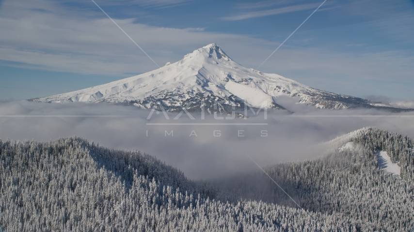 Low clouds and snowy forest at the base of Mount Hood, Cascade Range, Oregon Aerial Stock Photos | AX154_111.0000000F