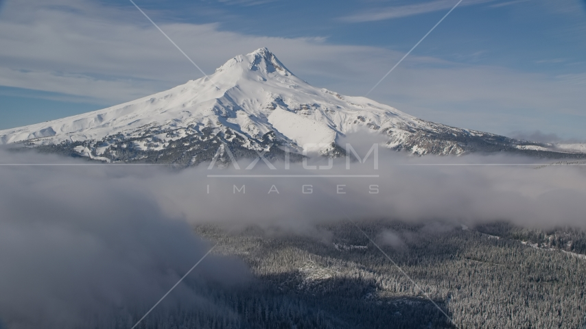 Snow-capped mountain peak and low clouds, Mount Hood, Cascade Range, Oregon Aerial Stock Photo AX154_117.0000237F | Axiom Images
