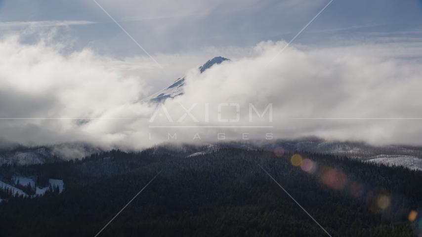 Clouds blocking the snowy summit of Mount Hood, Cascade Range, Oregon Aerial Stock Photos   AX154_131.0000213F