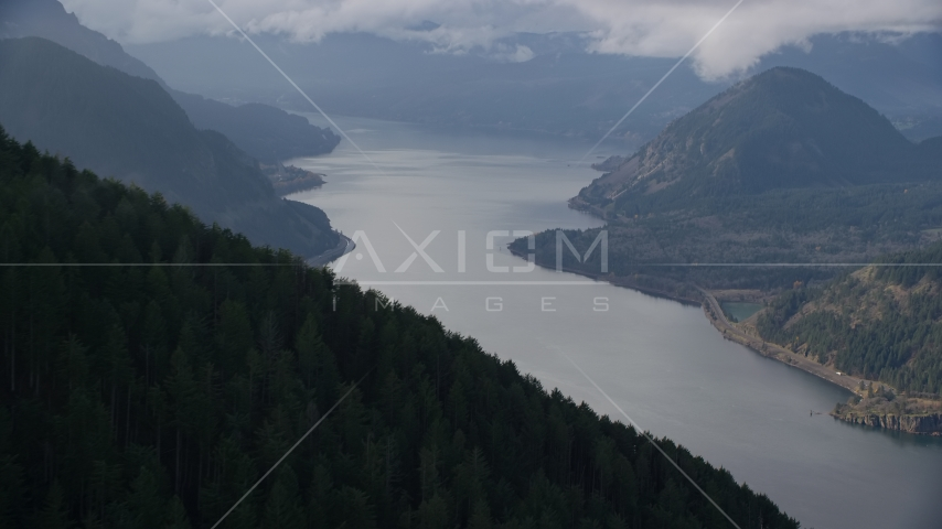 An evergreen forest mountain overlooking the Columbia River Gorge, Hood River County, Oregon Aerial Stock Photo AX154_154.0000255F | Axiom Images
