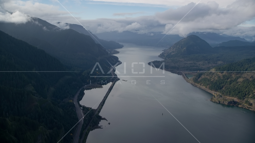 The I-84 highway at the base of mountains in Columbia River Gorge Aerial Stock Photos | AX154_156.0000000F