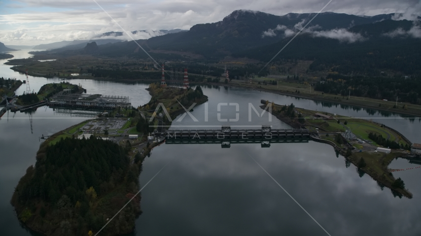 The Bonneville Dam structures on the Columbia River in the Columbia River Gorge Aerial Stock Photos | AX154_177.0000071F