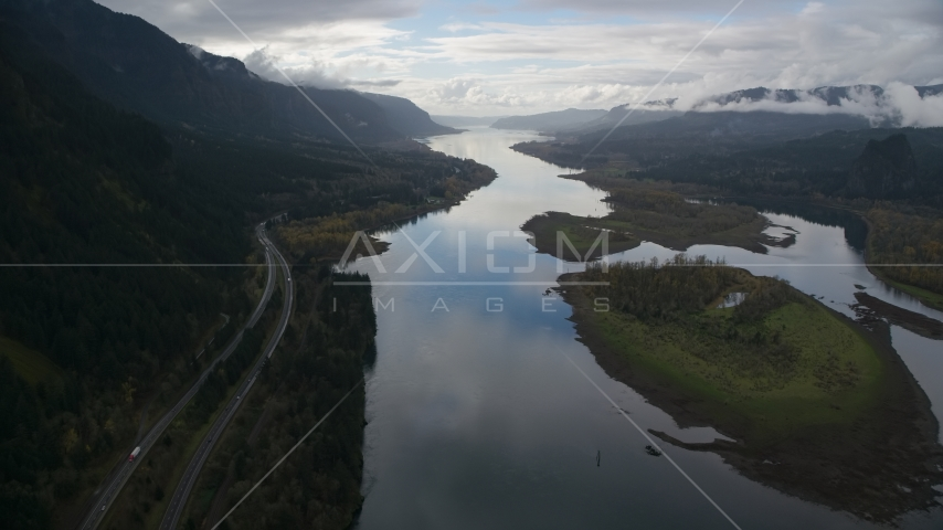 Columbia River and the I-84 highway by islands in the Columbia River Gorge Aerial Stock Photos | AX154_180.0000321F