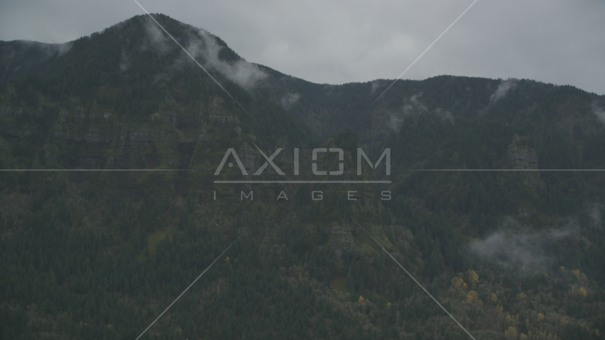 Rugged mountain cliffs and misty clouds on the Oregon side of Columbia River Gorge Aerial Stock Photos | AX154_185.0000000F