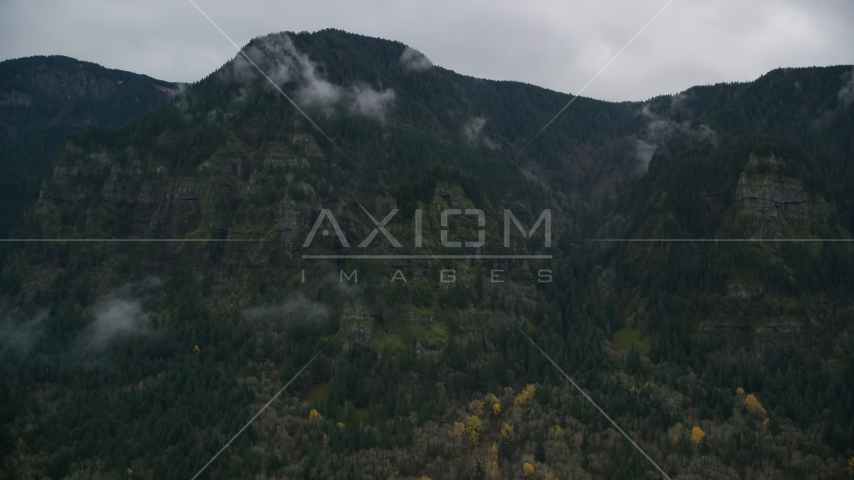 Rugged mountain cliffs and misty clouds on the Oregon side of Columbia River Gorge Aerial Stock Photos | AX154_185.0000238F