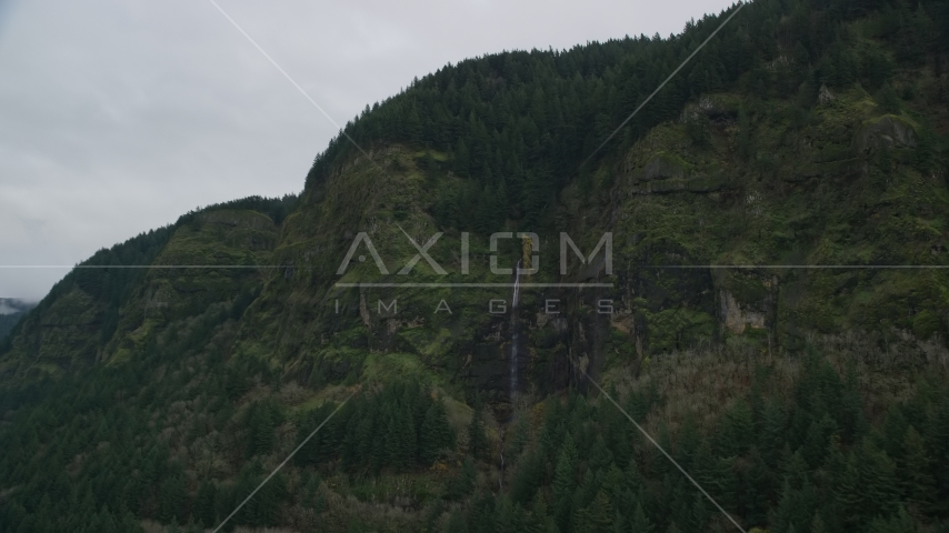 A waterfall on green cliffs on the Oregon side of Columbia River Gorge Aerial Stock Photos AX154_187.0000212F | Axiom Images