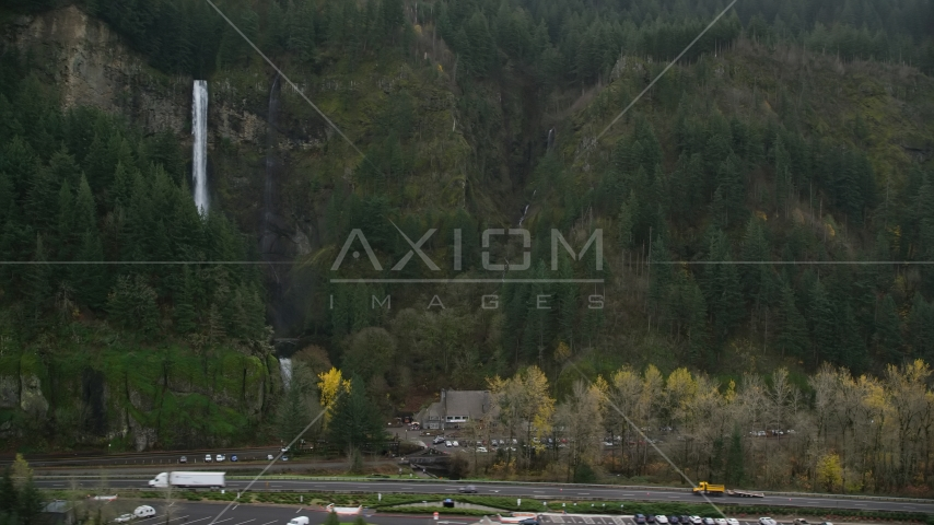 The I-84 highway below Multnomah Falls on a cliff face of the Columbia River Gorge Aerial Stock Photos | AX154_189.0000235F