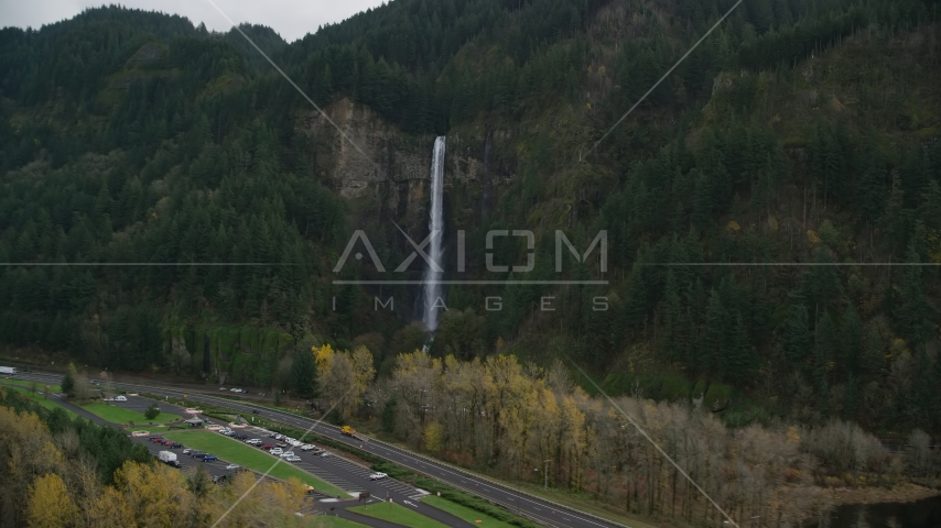 Interstate 84 and Multnomah Falls on a cliff face of the Columbia River Gorge Aerial Stock Photos | AX154_189.0000367F