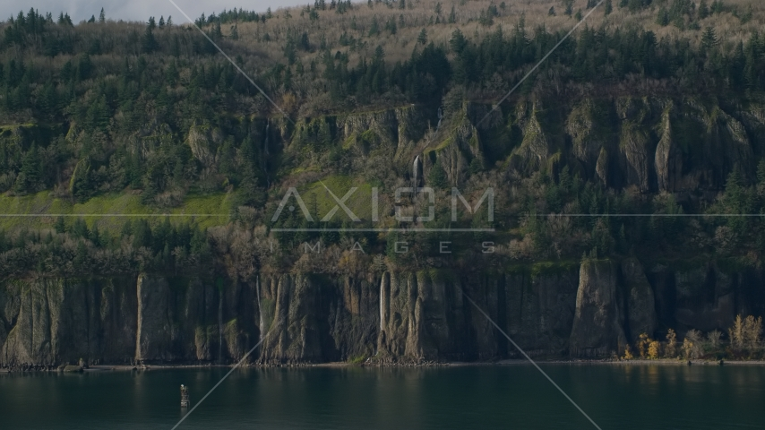 Waterfalls and steep green cliffs on the Washington side of Columbia River Gorge Aerial Stock Photos | AX154_193.0000000F