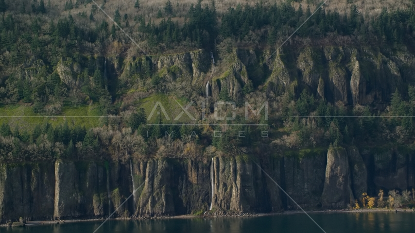 Waterfalls and steep green cliffs on the Washington side of Columbia River Gorge Aerial Stock Photos | AX154_193.0000228F