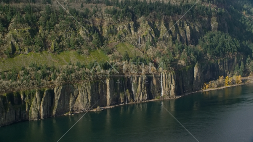 Four waterfalls on steep green cliffs and Columbia River on the Washington side of Columbia River Gorge Aerial Stock Photo AX154_195.0000000F | Axiom Images
