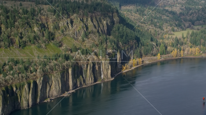 Four waterfalls on steep green cliffs beside the Columbia River on the Washington side of Columbia River Gorge Aerial Stock Photo AX154_195.0000171F | Axiom Images
