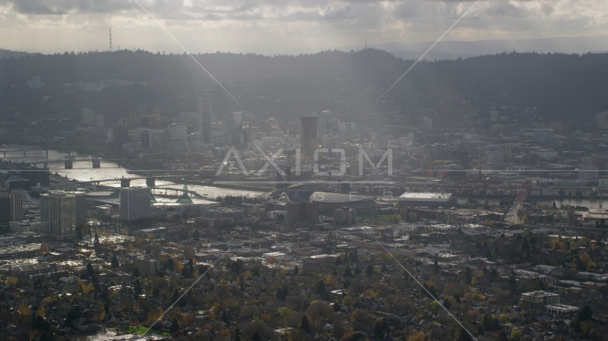 Godrays shining down on Moda Center, the Willamette River and Downtown Portland, Oregon Aerial Stock Photos | AX154_224.0000000F