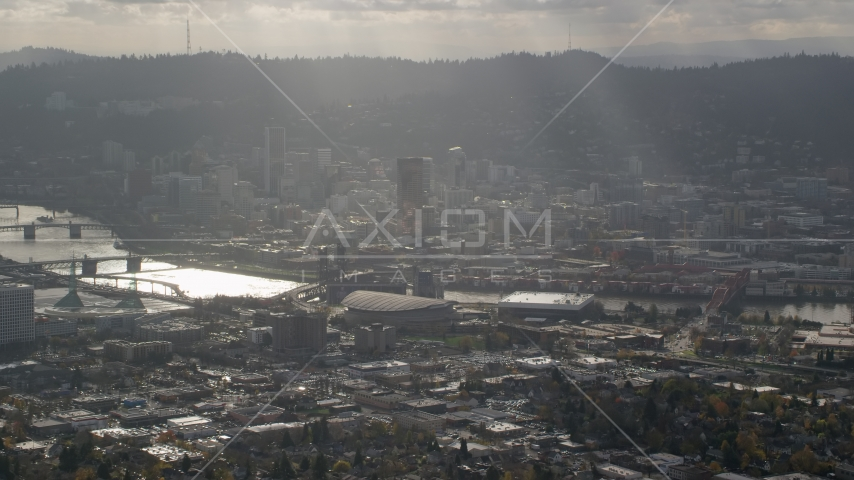 Godrays shining on Moda Center, the Willamette River and Downtown Portland, Oregon Aerial Stock Photo AX154_224.0000249F | Axiom Images