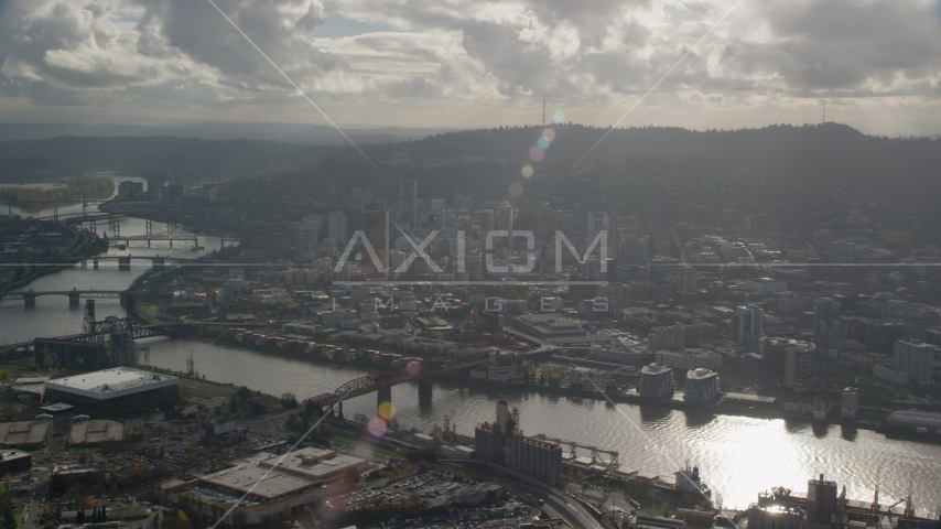 The Willamette River and Downtown Portland, Oregon with godrays shining down Aerial Stock Photo AX154_227.0000000F | Axiom Images