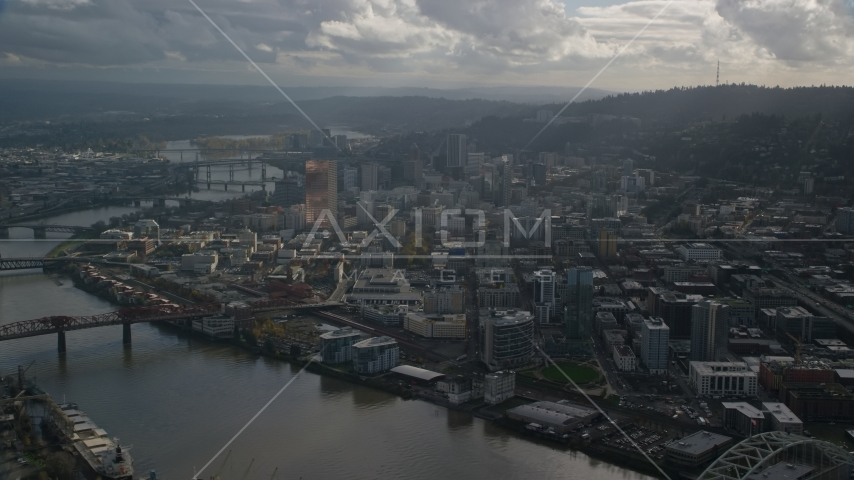 Willamette River and Downtown Portland, Oregon with godrays shining down from the clouds Aerial Stock Photo AX154_227.0000336F | Axiom Images
