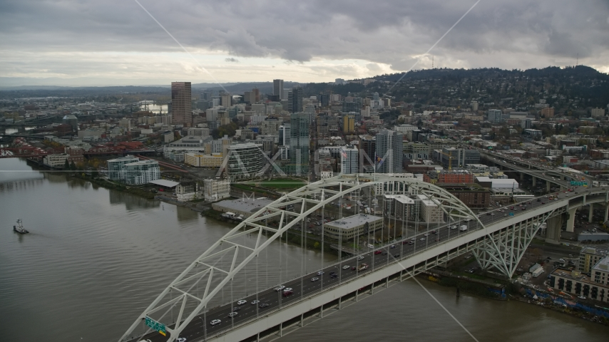 Fremont Bridge near skyscrapers in Downtown Portland, Oregon Aerial Stock Photos | AX155_035.0000270F
