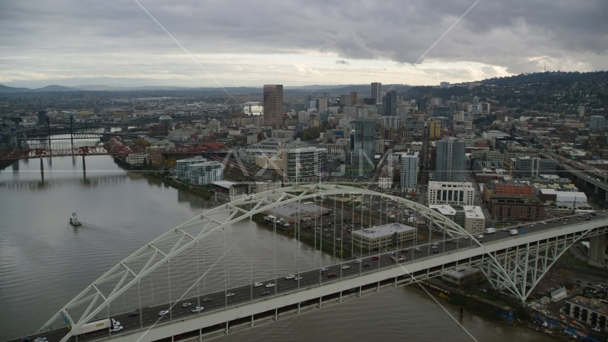 Fremont Bridge and skyscrapers in Downtown Portland, Oregon Aerial Stock Photos | AX155_036.0000000F
