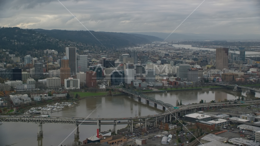 Ross Island Bridge, the Hawthorne Bridge, and skyscrapers in Downtown Portland, Oregon Aerial Stock Photo AX155_046.0000196F | Axiom Images