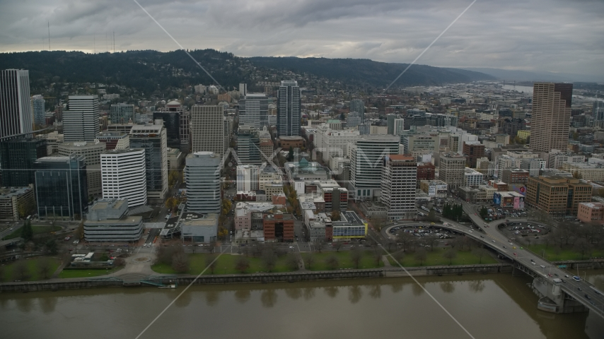 Skyscrapers, downtown buildings, and city park near the river in Downtown Portland, Oregon Aerial Stock Photo AX155_051.0000183F | Axiom Images