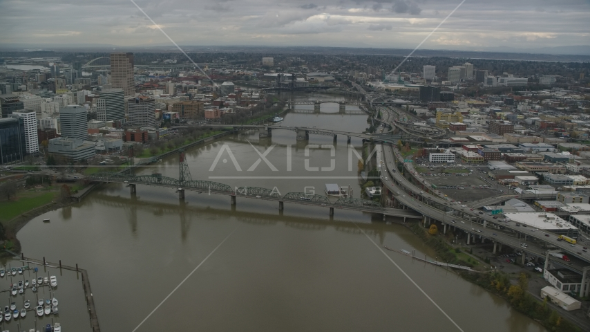 Downtown skyscrapers and Hawthorne Bridge spanning the Willamette River in Downtown Portland, Oregon Aerial Stock Photos | AX155_061.0000299F