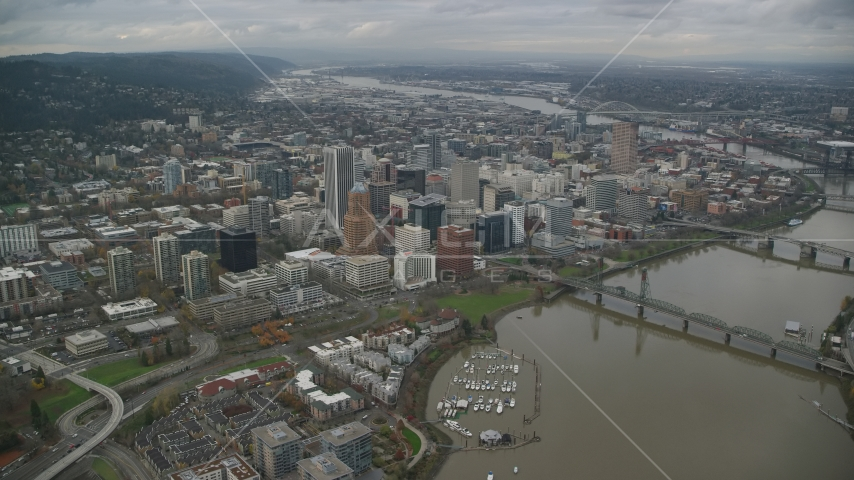 A view of Downtown Portland cityscape and waterfront park seen from the bridges over the Willamette River in Oregon Aerial Stock Photo AX155_094.0000000F | Axiom Images