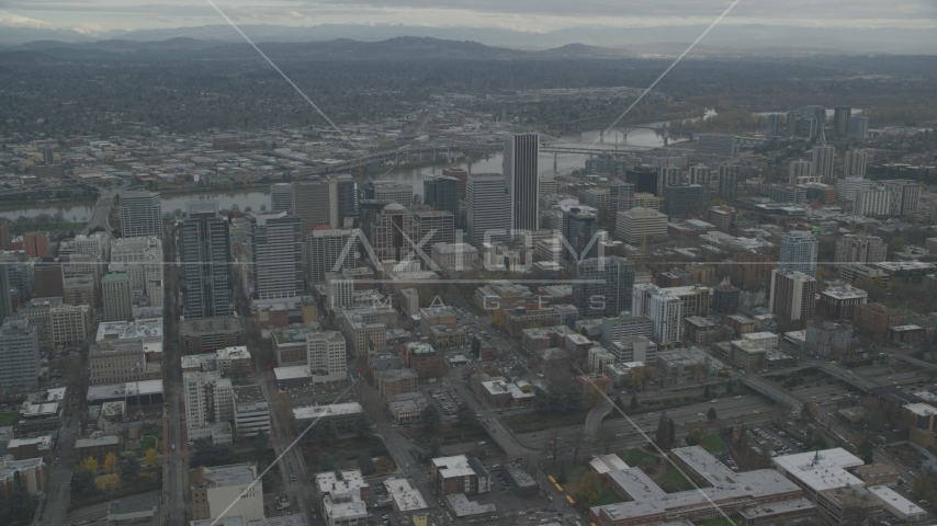 Downtown Portland cityscape with Willamette River behind it in Oregon Aerial Stock Photos | AX155_100.0000000F