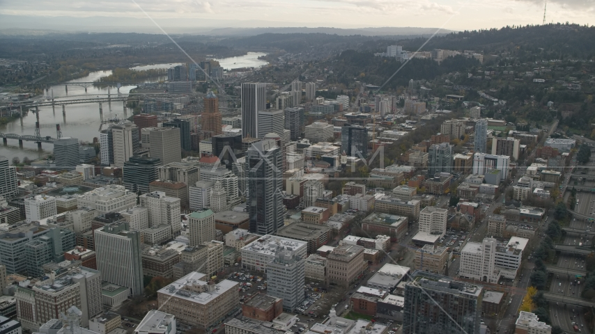 Downtown Portland cityscape with Willamette River behind it in Oregon Aerial Stock Photo AX155_101.0000295F | Axiom Images