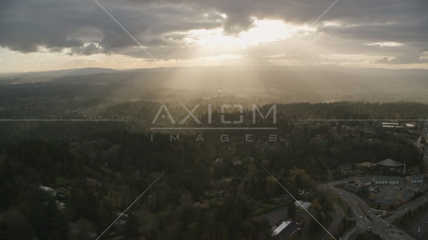 Godrays shining on neighborhoods and Highway 26, Southwest Portland, Oregon Aerial Stock Photos | AX155_118.0000000F