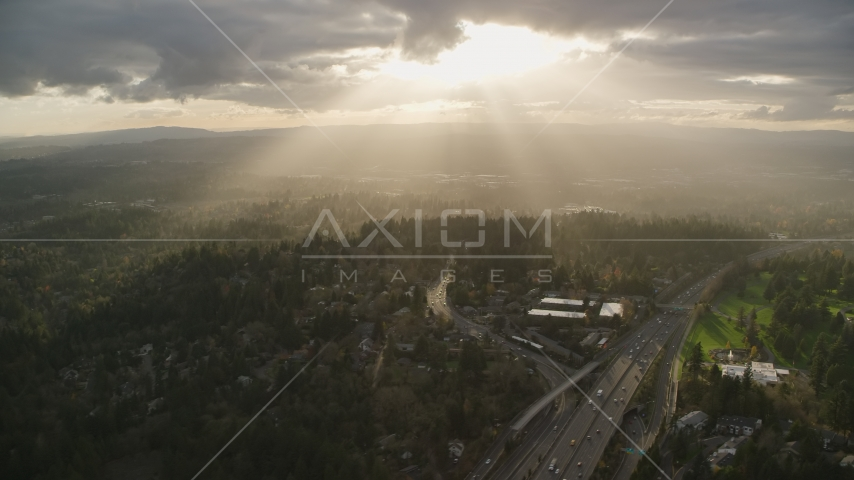 Godrays shining on neighborhoods and Highway 26, Southwest Portland, Oregon Aerial Stock Photo AX155_118.0000246F | Axiom Images