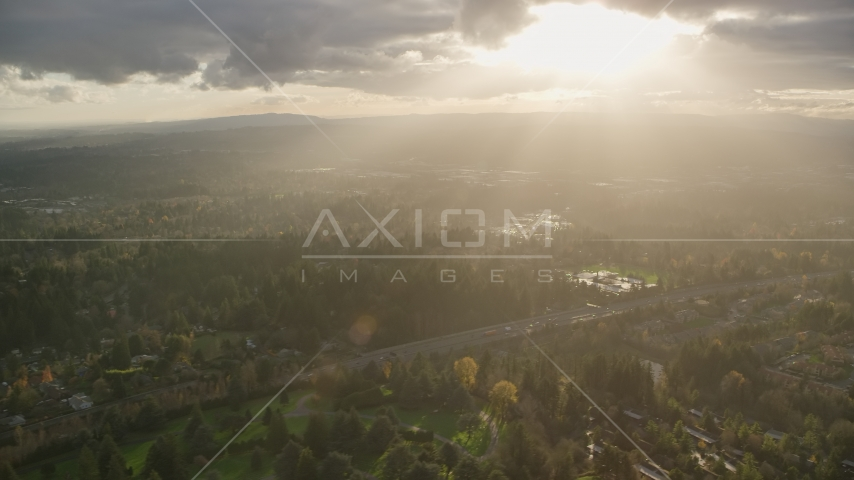 Godrays shining down on suburban neighborhoods and Highway 26, Southwest Portland, Oregon Aerial Stock Photos | AX155_119.0000265F