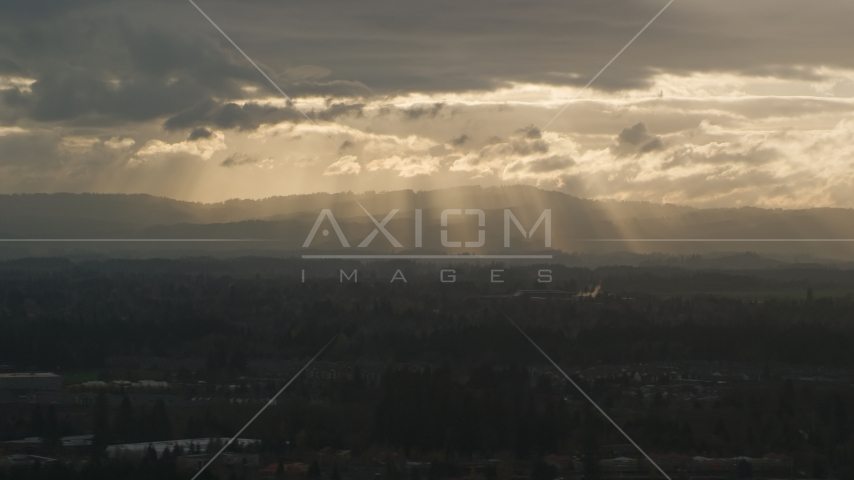 Distant mountains and godrays from the clouds near Beaverton, Oregon, at sunset Aerial Stock Photos | AX155_125.0000111F