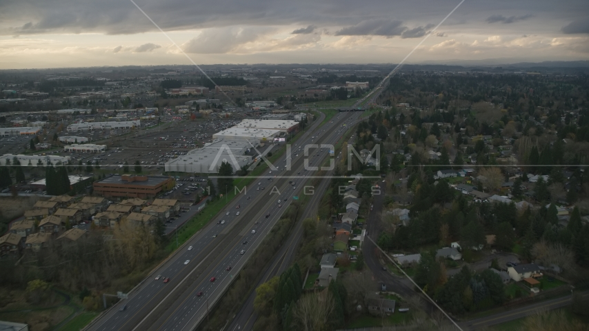 Apartment buildings along Highway 26 by Tanasbourne Town Center in Hillsboro, Oregon, sunset Aerial Stock Photo AX155_127.0000321F | Axiom Images