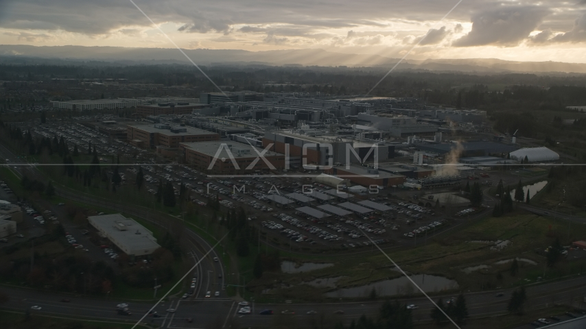 Intel Ronler Acres with godrays in the background, in Hillsboro, Oregon, sunset Aerial Stock Photos | AX155_131.0000121F