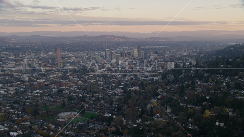 Downtown Portland at sunset, seen from hillside houses in Northwest Portland, Oregon Aerial Stock Photos | AX155_141.0000349F