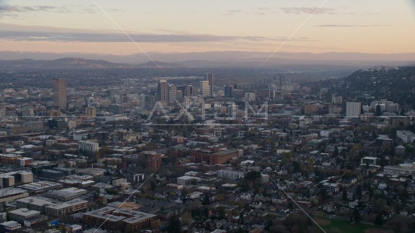 Downtown Portland skyscrapers at sunset, seen from Northwest Portland, Oregon Aerial Stock Photos | AX155_142.0000254F