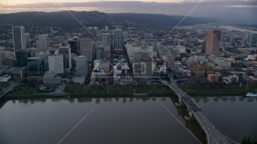 Downtown Portland skyscrapers and city park seen across the Willamette River at sunset Aerial Stock Photo AX155_153.0000340F | Axiom Images