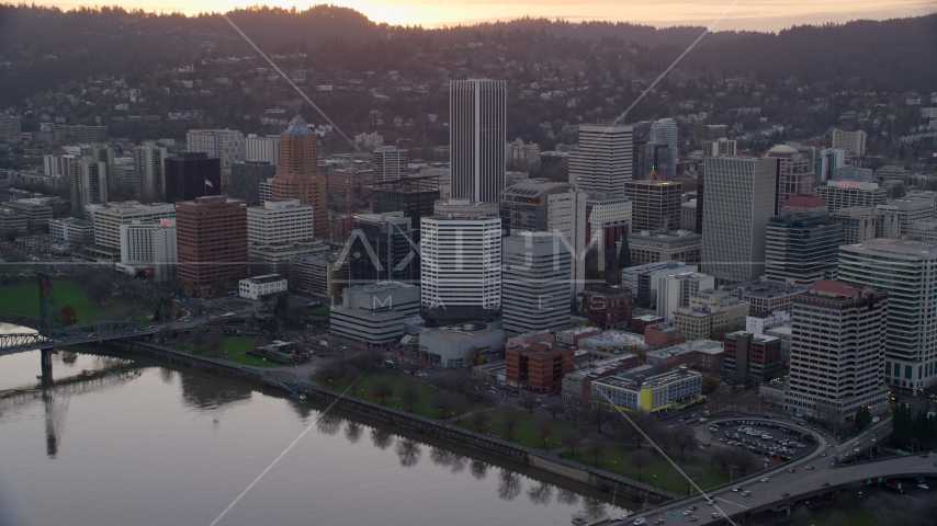 Downtown Portland skyscrapers and city park beside the Willamette River at sunset Aerial Stock Photo AX155_154.0000181F | Axiom Images