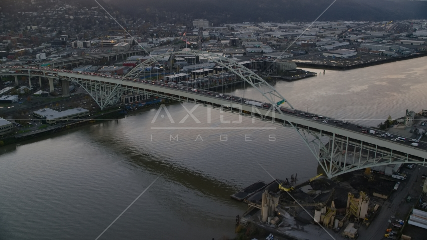 Heavy traffic crossing the Fremont Bridge at sunset in Downtown Portland, Oregon Aerial Stock Photo AX155_158.0000038F | Axiom Images