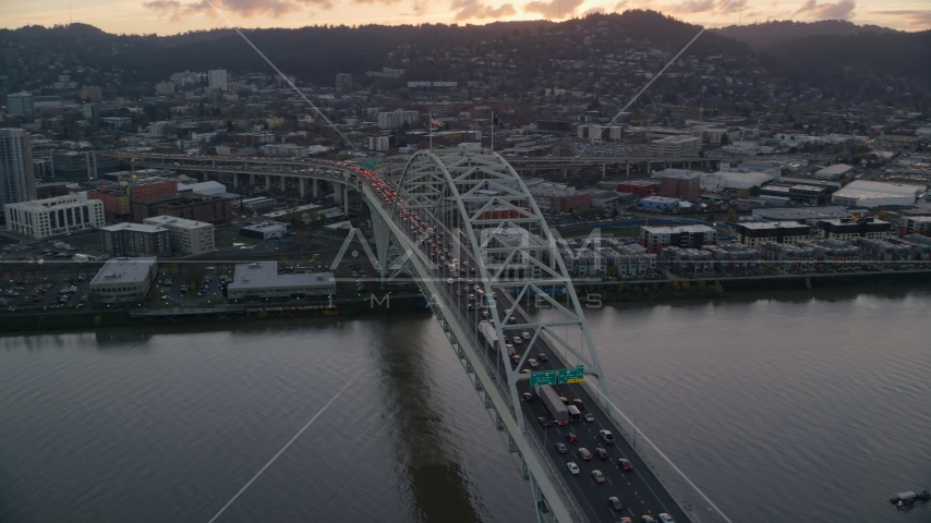 Heavy traffic crossing the Fremont Bridge at sunset in Downtown Portland, Oregon Aerial Stock Photo AX155_158.0000229F | Axiom Images