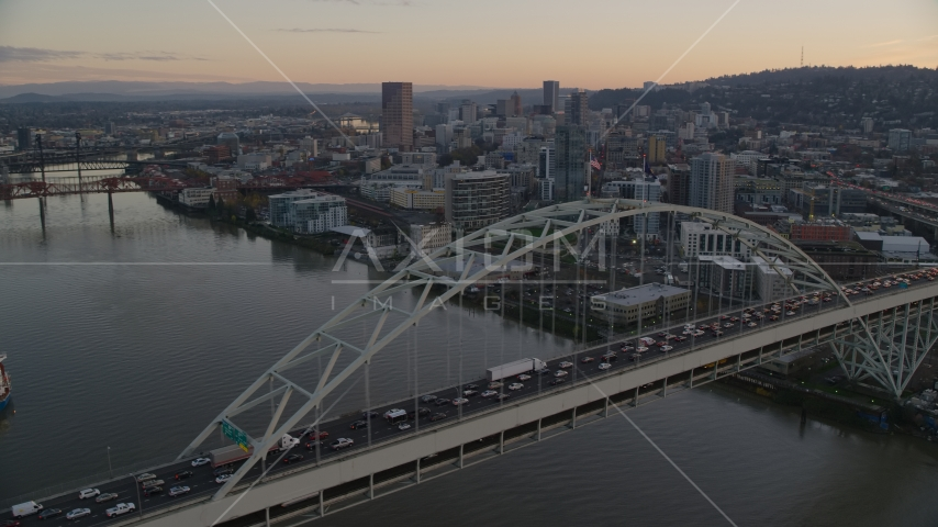 Heavy traffic crossing the Fremont Bridge at sunset, near Downtown Portland, Oregon Aerial Stock Photo AX155_159.0000302F | Axiom Images