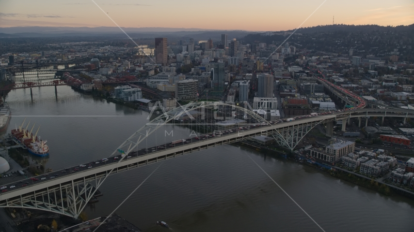 Heavy traffic on the Fremont Bridge at sunset, Downtown Portland in the background, Oregon Aerial Stock Photos | AX155_161.0000096F