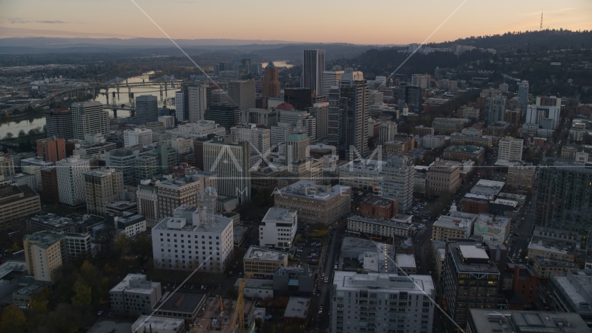 NW 10th Avenue through Downtown Portland, Oregon, at sunset to Park Avenue West Tower Aerial Stock Photos | AX155_164.0000248F