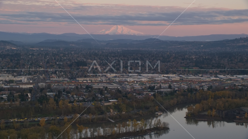 Mount Hood in the far distance at sunset, seen from a train yard in Southeast Portland, Oregon Aerial Stock Photos | AX155_169.0000000F
